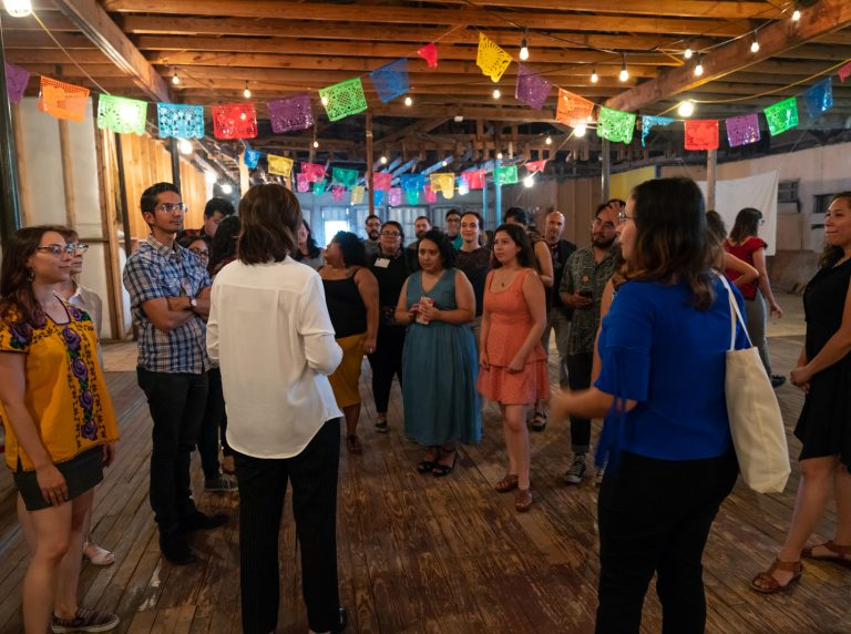 Maria Addressing 2018 NLI Cohort in Buena Vista Gardens Building
