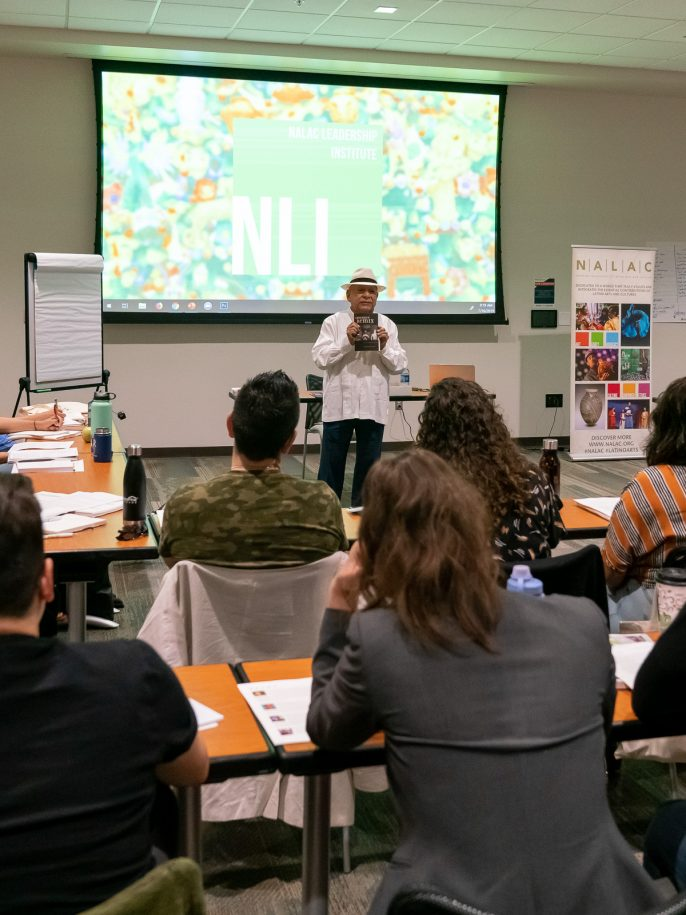 "Tomás Ybarra-Frausto speaks to the 2019 NLI class during his session titled ""No Llegamos Ayer, y No Nos Vamos Mañana"""