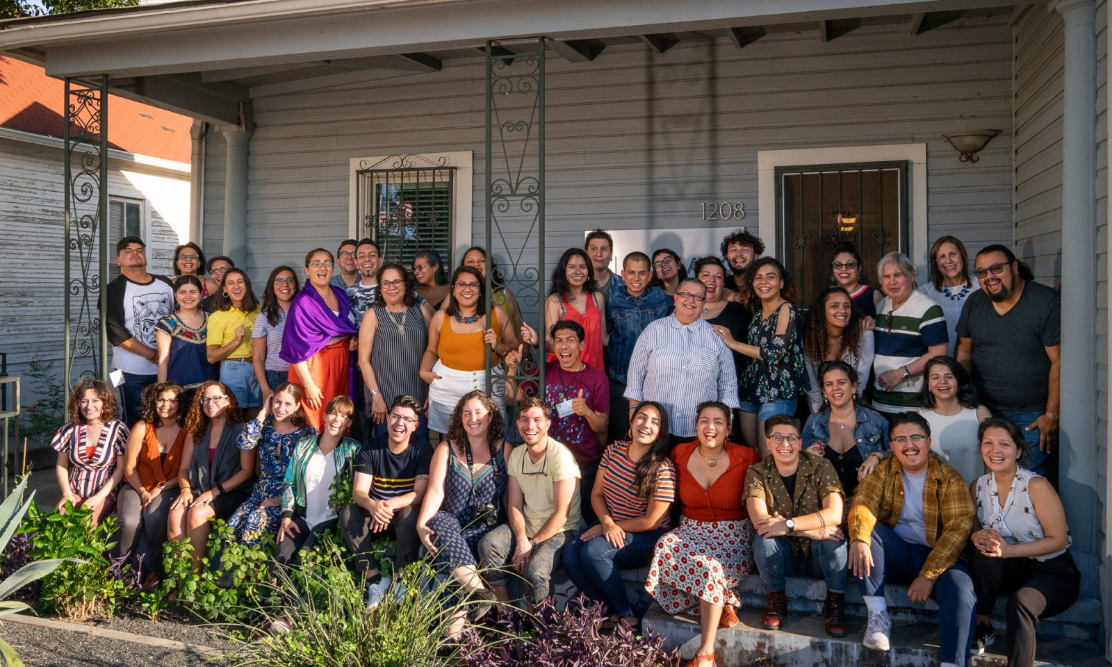 Group photo of NLI Fellows, Faculty and staff on the patio at NALAC offices.