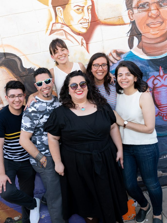 NLI Fellows pose in fornt of Buena Vista Garden Building Mural.